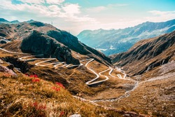Mountains and nature of Switzerland. Travel and hobby concepts. Maloja Serpentine Trail. Maloja pass winding road in the alps of Canton Graubünden in Switzerland.