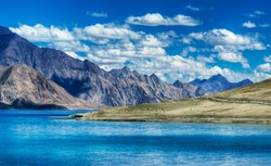 Mountains and Pangong tso (Lake). It is huge lake in Ladakh, altitude 4,350 m (14,270 ft). It is 134 km (83 mi) long and extends from India to Tibet. Leh, Ladakh, Jammu and Kashmir, India