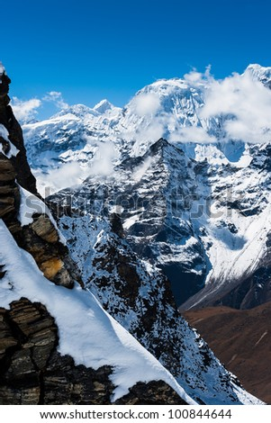 Mountains and rocks viewed from Renjo pass in Himalayas.Travel to Nepal - stock photo
