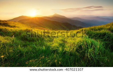 Mountains during sunset. Beautiful natural landscape in the summer time #407021107