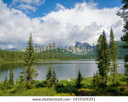 Mountains Ergaki Park. Lake Light. In the distance, you can see the peak of the bird and the peak of Star
