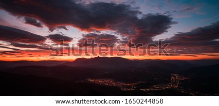 Mountains, golden sunrise and clouds. Sunrise in Aralar and Ordizia seen from Usurbe.