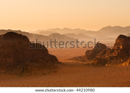 Mountains in sunset receding into background. Wadi Rum desert, Jordan.