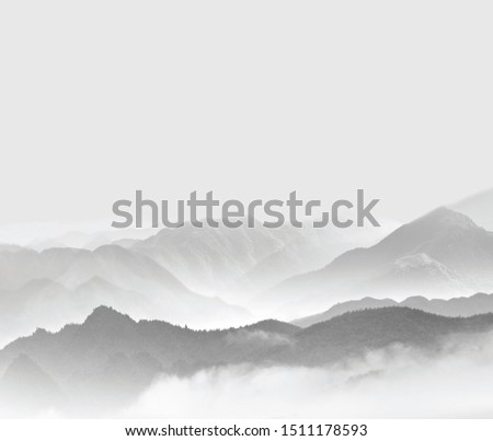 Mountains in the fog. Gray mountains in the fog. Mountains on a gray background