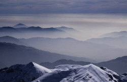 Mountains in the mist layer background