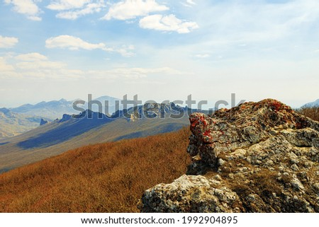Mountains landscape against blue sky with clouds on sunny day