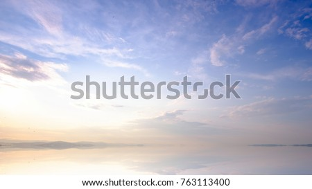 Mountains landscape at sunrise - cloudy sky in pastel colors for your design #763113400