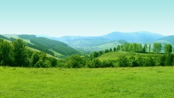 Mountains Landscape with Grass Meadow on Foreground