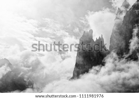 Mountains of the famous Sesto Dolomites with clouds and fog around, black and white photo, Alps, south tyrol, Italy, Europe