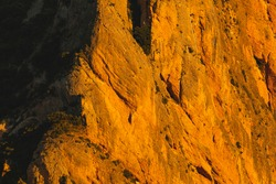 Mountains of the Mallos of Riglos, vertical rock walls at sunset, a famous place for climbing near the Gallego river, in the pre-Pyrenees, Huesca province, Aragon, Spain.