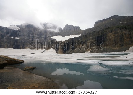 Mountains over Icy Glacial Lake