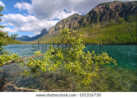 Mountains rise steeply from the shoreline of Kintla Lake in Glacier National Park