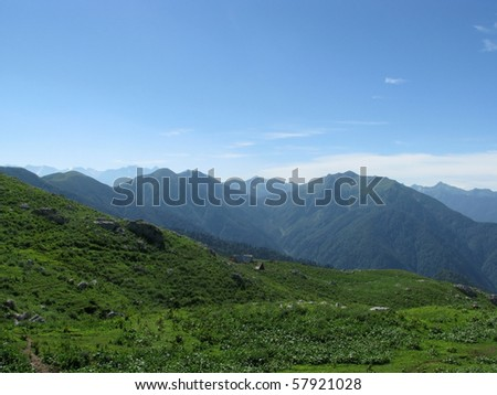 Mountains, rocks; a relief; a landscape; a hill; a panorama; Caucasus; top; a slope; clouds; the sky; a landscape