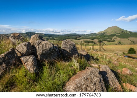 Mountains Rocks Valley Summer Rocky hilltop in the mountain landscape valley terrain with distant trees in summer
