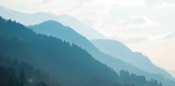 Mountains silhouette in the morning mist landscape