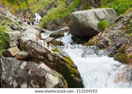 Mountains stream through rocky Altai mountains. Siberia, Russia