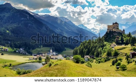 Mountains surrounding Tarasp, a village in the canton of Graubunden, Switzerland. It is dominated by the famous castle overlooking the village.