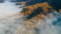 mountains tops high above clouds fog