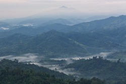 mountains under mist in the morning with beautiful sky in Phu Phaya Pho, Phrae Province, Thailand
