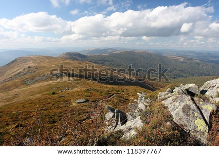 Mountains under the white cloudy sky - stock photo