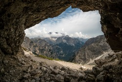 Mountains visible from inside a cave