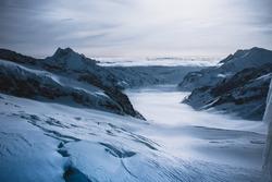 Mountains Winter landscape. Surrealistic cold colors. Swiss Alps.