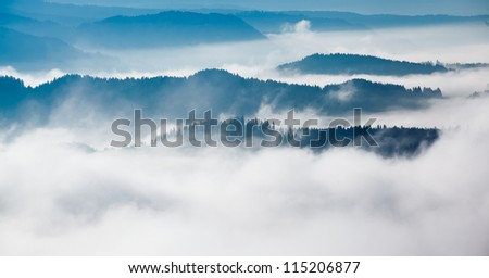 Mountains with fog,morning in the valley