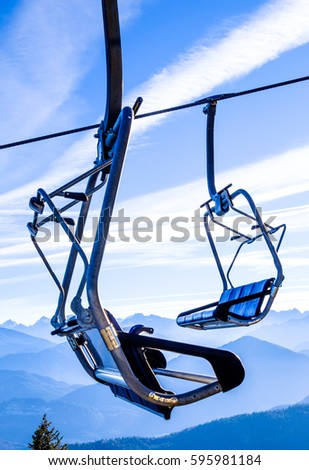 mountains with modern ski lift chairs #595981184
