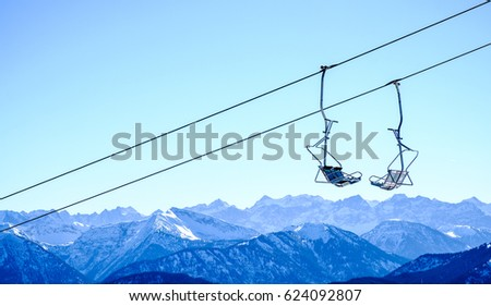mountains with modern ski lift chairs #624092807