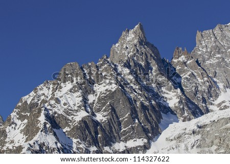 Mountains with snow and blue skies
