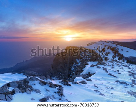 Mountains with snow during bright sundown