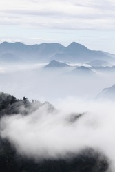 mountains with trees and fog in monochrome color shot in taiwan asian
