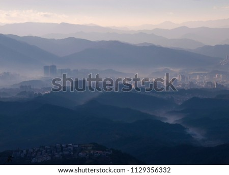 mountains with yellow sunrise and more house