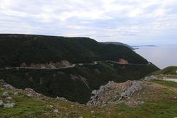 Mountainside Road facing Atlantic Ocean on the Cabot Trail in Cape Breton, Nova Scotia
