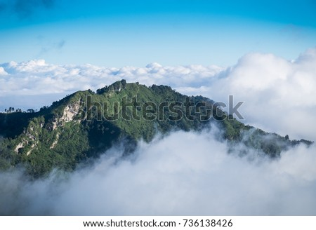 Mountaintop stand out from the sea of mist. The beautiful scenic as reward for tourist who able to success climbing.