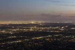 Mountaintop view of Pasadena and Los Angeles at dusk.