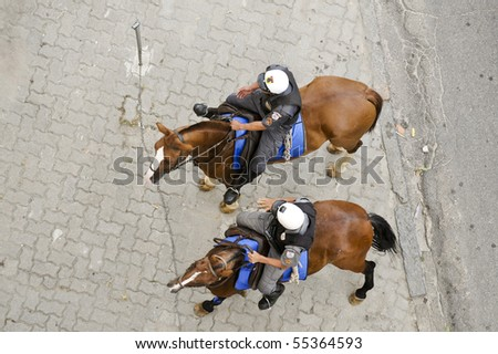 Mounted Police in a street - stock photo