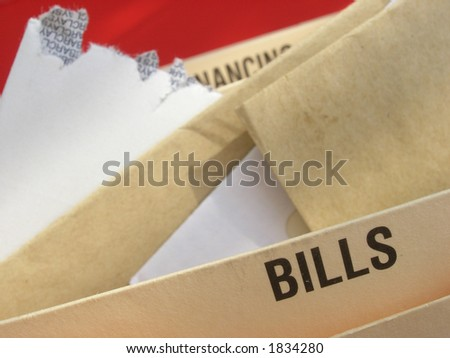 Mounting bills illustrating struggle with mounting debts.