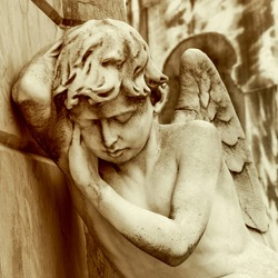 Mourning Angel Statue in Recoleta Cemetery, Buenos Aires, Argentina.