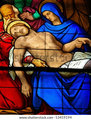 Mourning window in Dom of Cologne, Germany. This stained glass window shows the mourning of the dead Christ who rests in the lap of his mother. It was made in 1847.