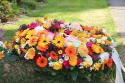 Mourning wreath with colorful flowers after a funeral