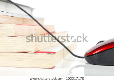 Mouse and book on white background