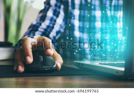 mouse click, man hand with mouse and laptop
