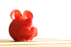 Mouse holding heart 3D printed.  Valentine's Day concept. Selective focus.