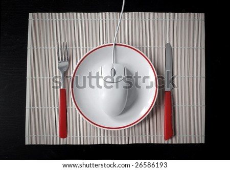 mouse on a dish between fork and knife