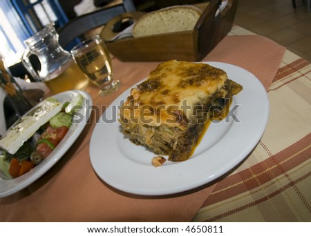 moussaka greek dish with greek salad and house wine in a taverna santorini