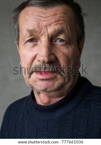 Moustached elderly man close-up portrait #777661036