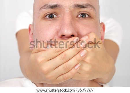 mouth covered - stock photo