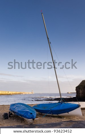 Mouth of the river Tyne / Tynemouth piers with sailing boats in foreground