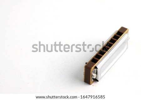 Photo of mouth organ isolated on white background. Image contains copy space